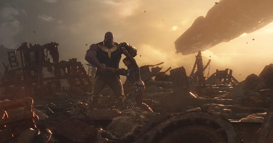 Iron Man (Tony Stark) fighting Thanos on Titan