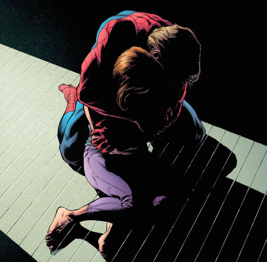 Peter Parker in Spider-Man costume without his mask holds Mary Jane in his arms
