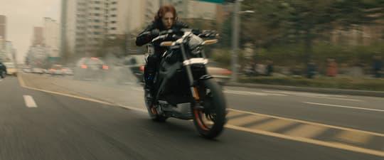 Natasha on a motorcycle