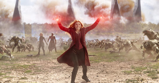 Wanda Maximoff (Scarlet Witch) on the battlefield fighting enemies in the Battle of Wakanda