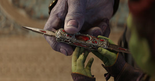 Thanos gifts Gamora a retractable bejeweled knife