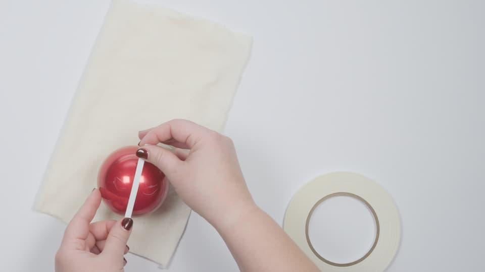 DIY Deadpool Holiday Ornament Craft - Use white grease pencil to sketch basic half-circle eye shape