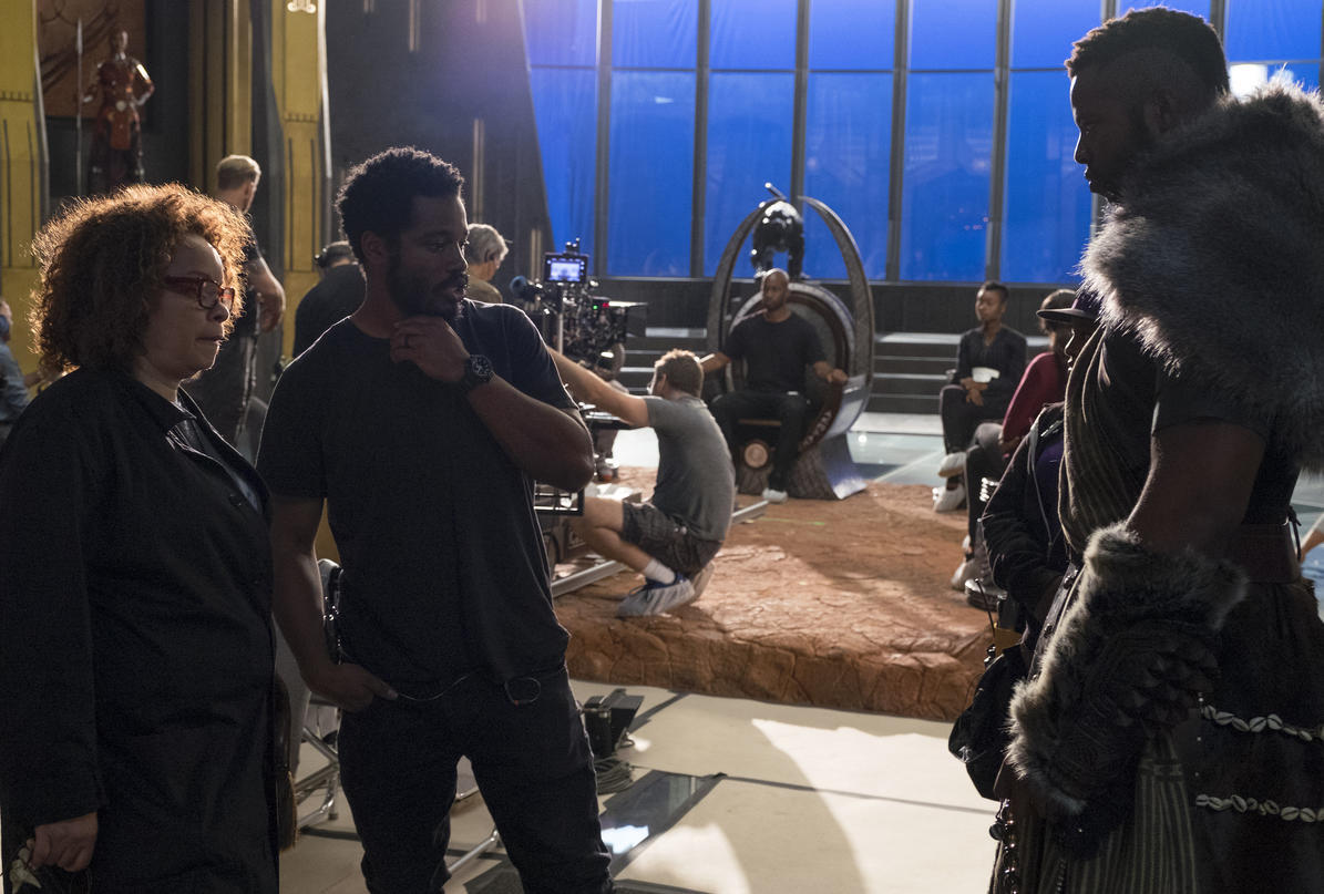 Costume Designer Ruth Carter and Director Ryan Coogler on set with Winston Duke (M'Baku)