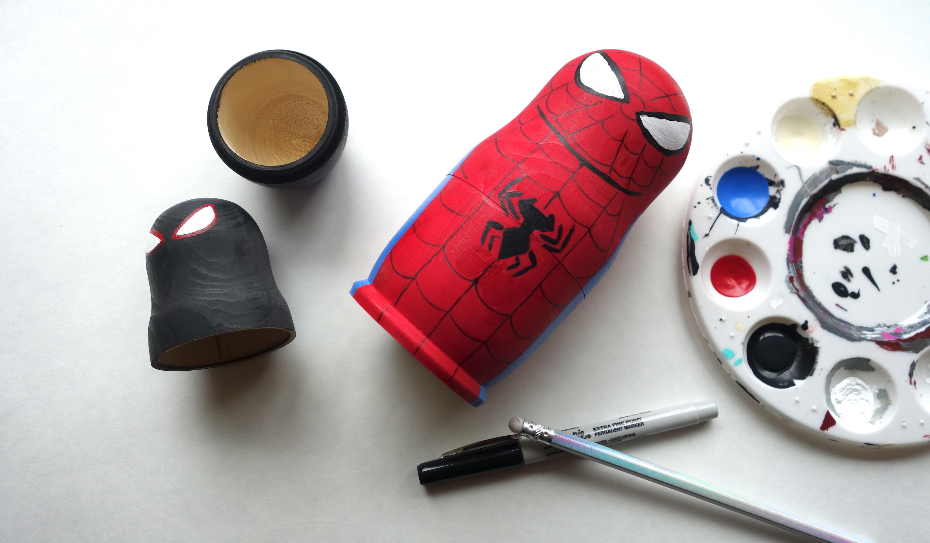 Spider-Geddon Nesting Dolls: Lightly draw the details of the center spider symbol