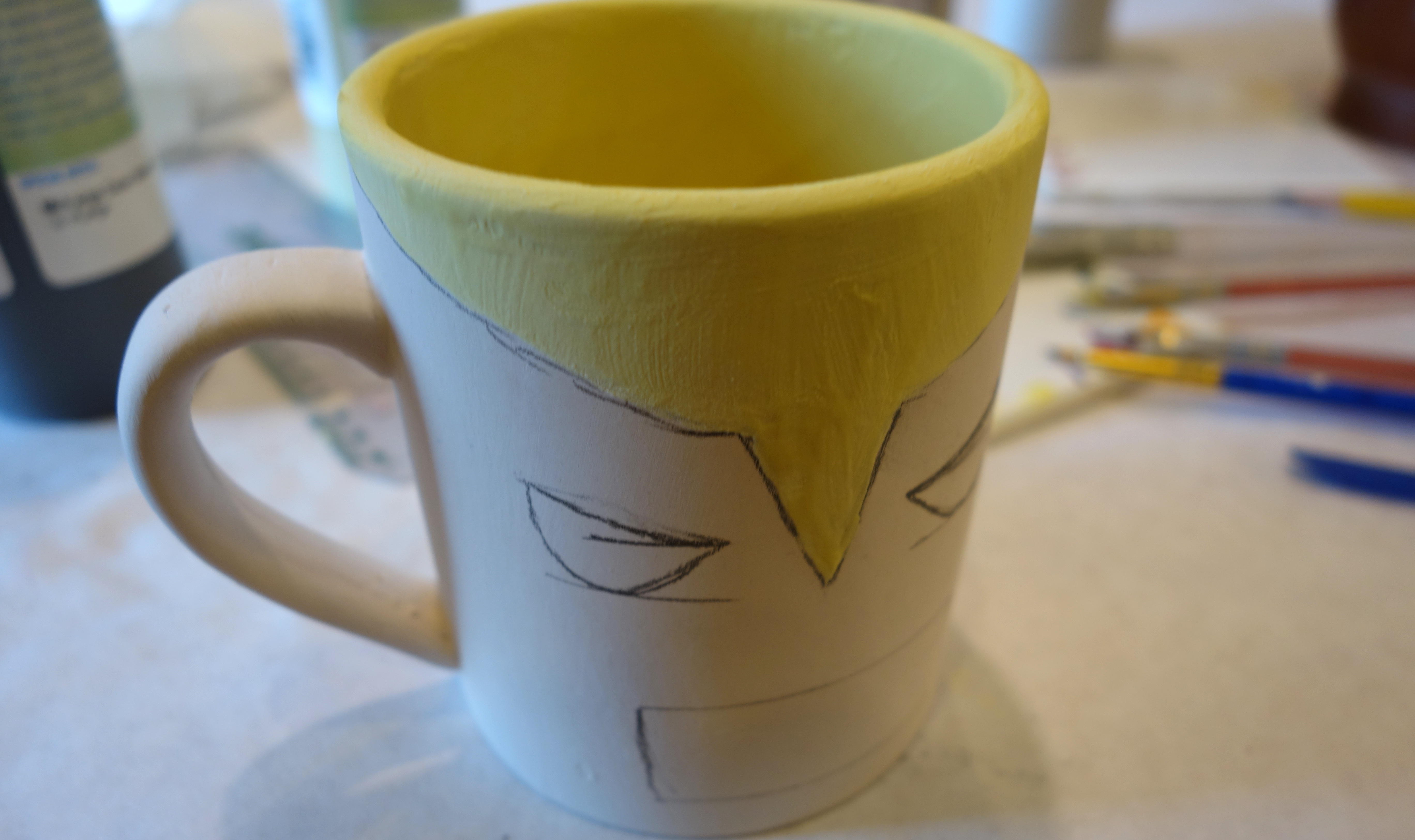 DIY Wolverine Mug Craft - Begin with the yellow paint on the outside of the mask