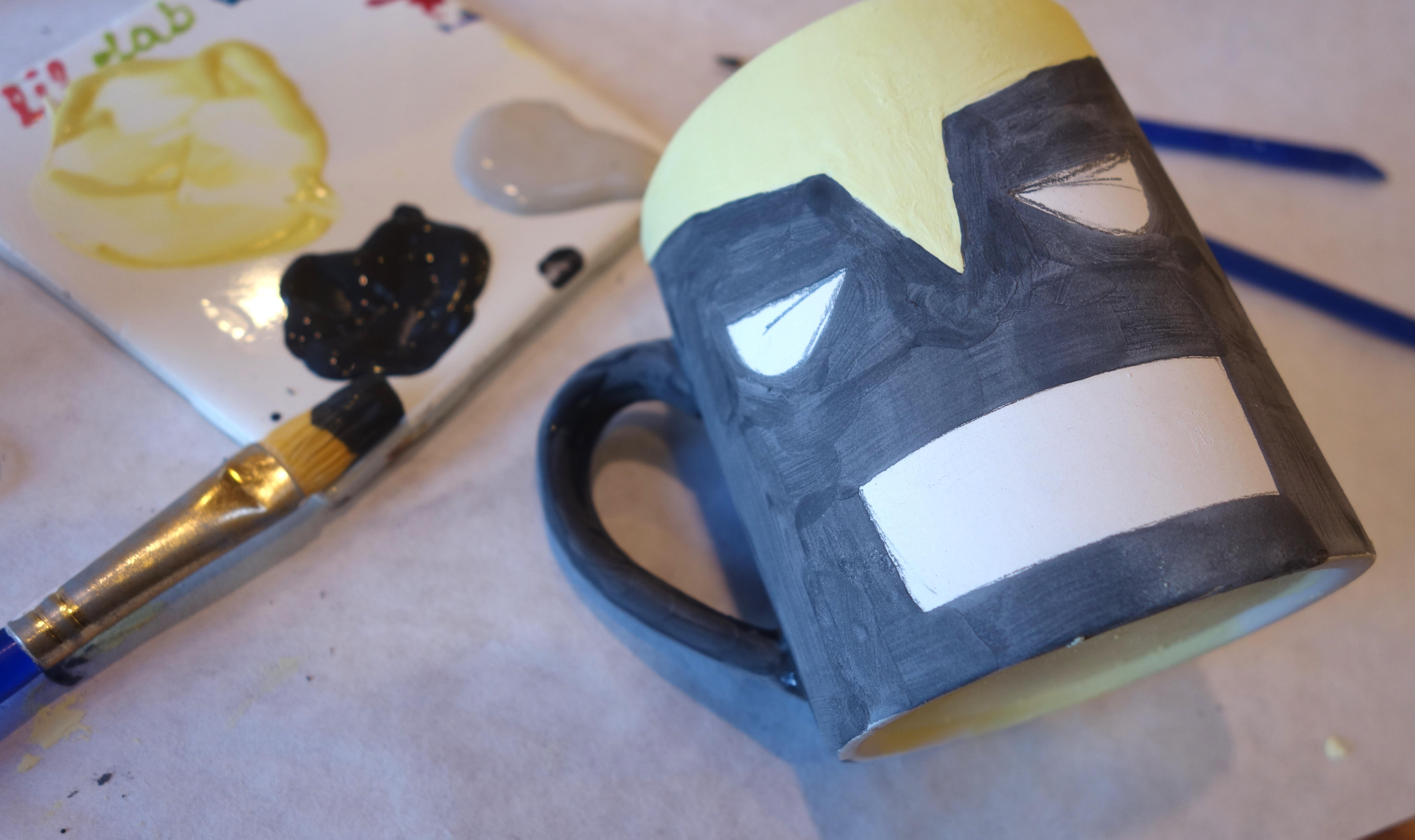 DIY Wolverine Mug - Paint in the black areas of Wolverine's mask.
