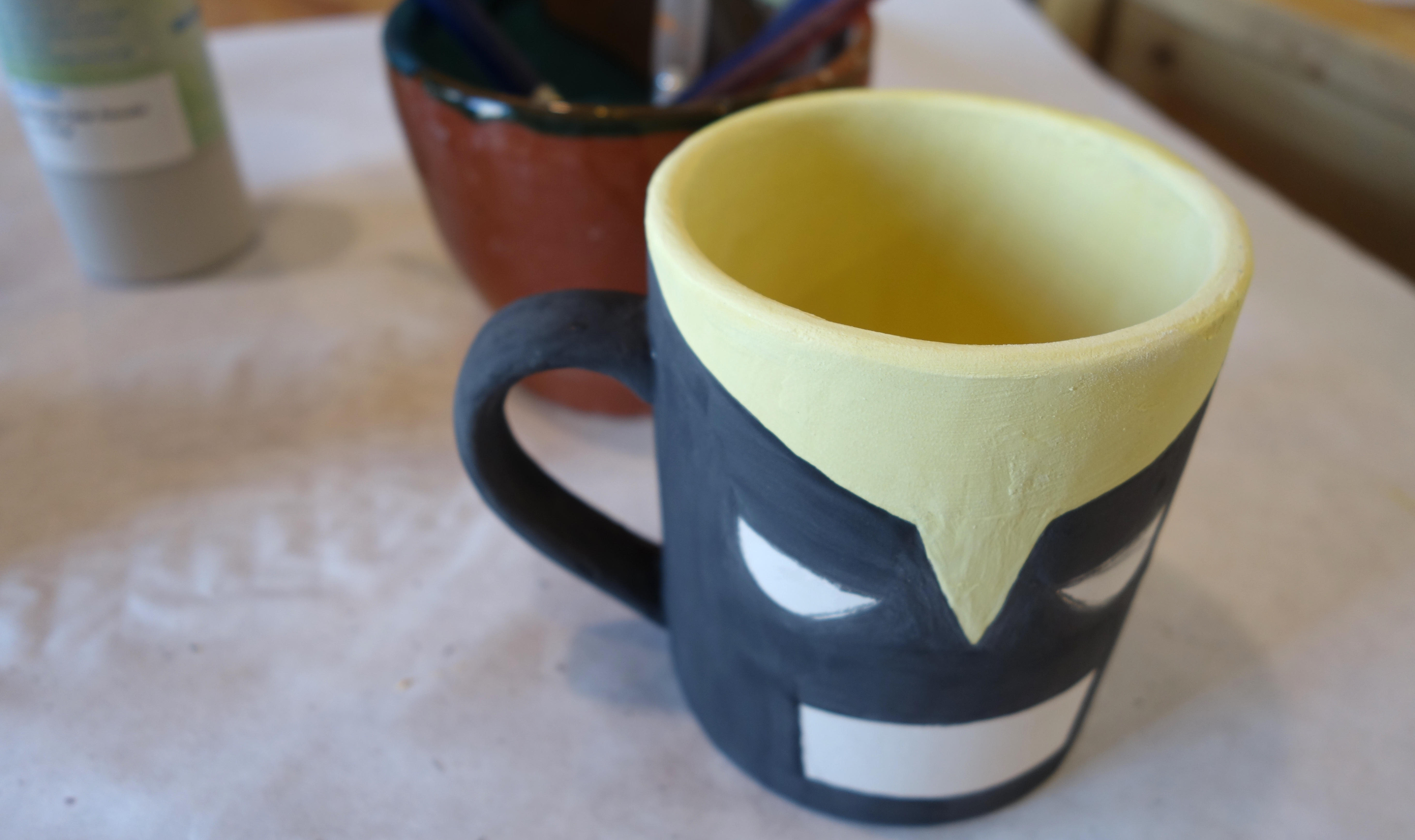 DIY Wolverine Mug Craft - You won't need to fill in any white paint in the eyes and mouth, but be sure to erase any heavy pencil lines that may still be left.